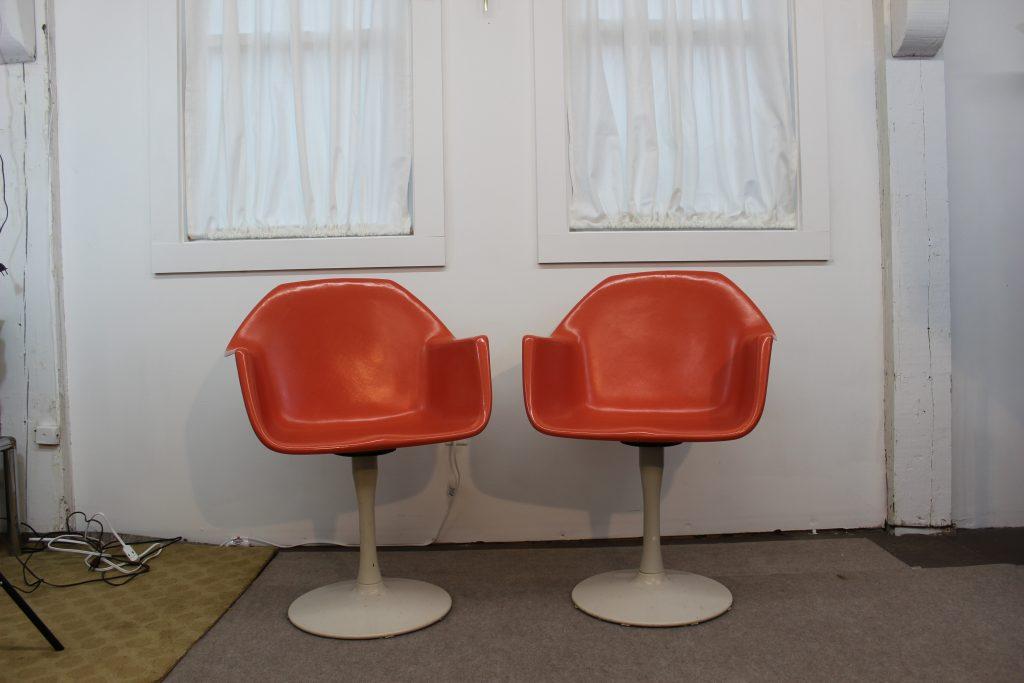 Orange fiberglass tulip base chairs
